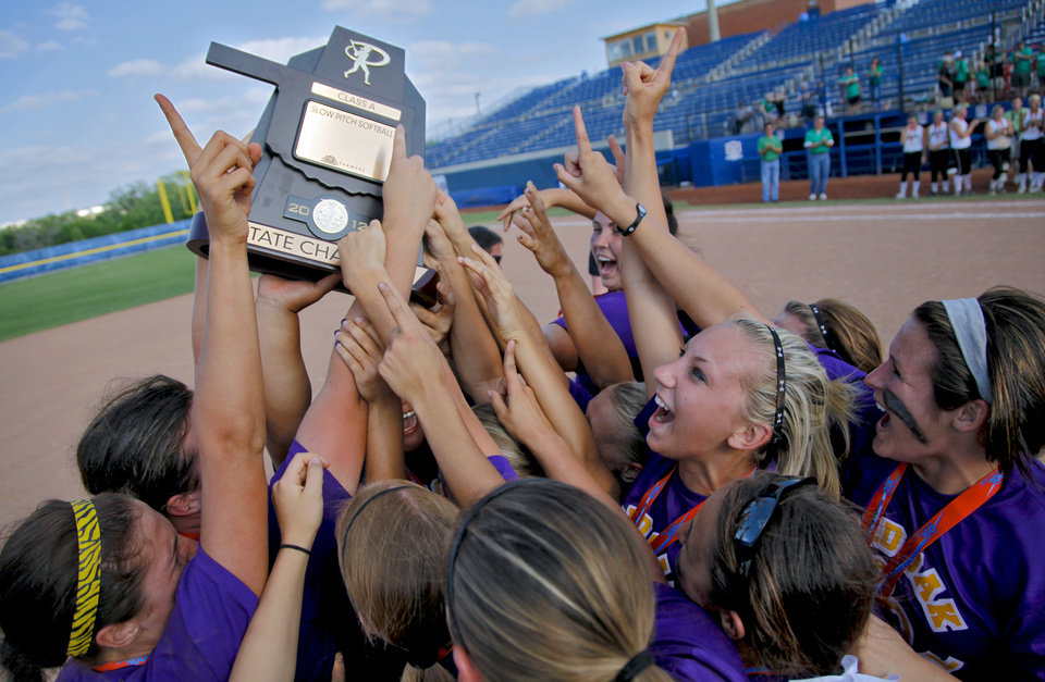 Members of the Red Oak softball team celebrate their 8-6 win over Leedey during the Class A state championship softball tournament at ASA Hall of Fame Stadium on Wednesday, May 2, 2012, in Oklahoma City, Oklahoma. Photo by Chris Landsberger, The Oklahoman
