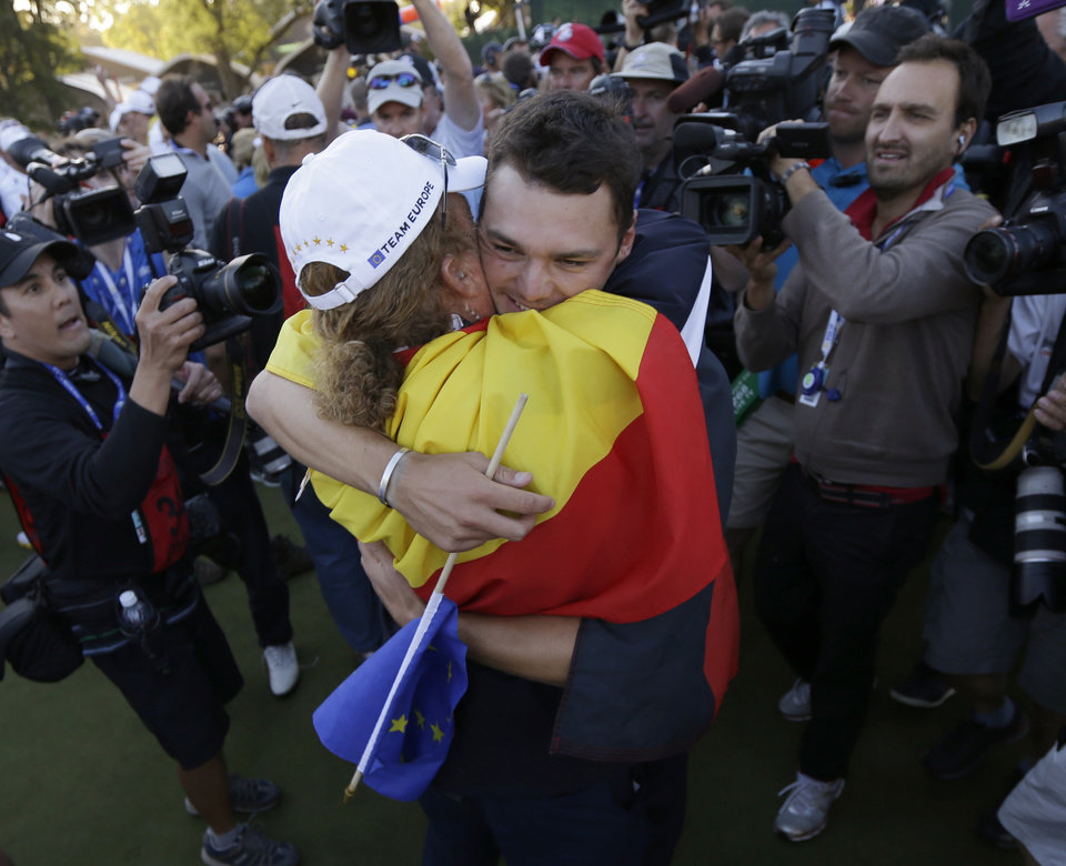 Europe's Martin Kaymer celebrates with Miguel ��ngel Jim�©nez after winning the Ryder Cup PGA golf tournament Sunday, Sept. 30, 2012, at the Medinah Country Club in Medinah, Ill. (AP Photo/David J. Phillip)