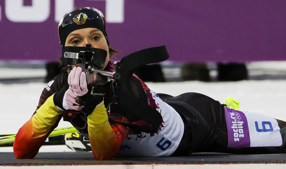 Photo - FILE - In this Feb. 9, 2014 file photo, Germany's Evi Sachenbacher-Stehle prepares to shoot during the women's biathlon 7.5k sprint, at the 2014 Winter Olympics, in Krasnaya Polyana, Russia. German Olympic officials said Sachenbacher-Stehle has been kicked out of the Sochi Games after a positive doping test. The German Olympic Committee said she tested positive on Monday, Feb. Feb. 17, for the stimulant methylhexanamine. Both the