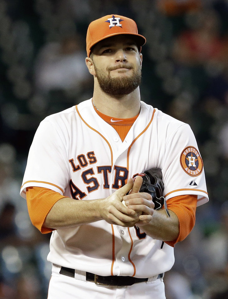 Photo - Houston Astros starting pitcher Dallas Keuchel reacts after walking Seattle Mariners' Brad Miller to load the bases in the seventh inning of a baseball game on Saturday, May 3, 2014, in Houston. (AP Photo/Pat Sullivan)