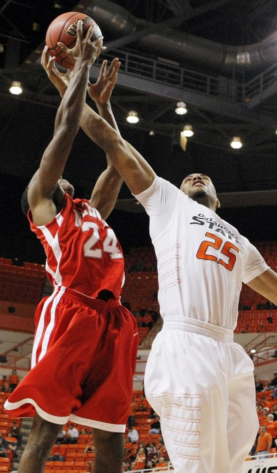Photo - OSU's Darrell Williams (25) tries to grab a rebound next to Kellan Carter (24) of Nicholls State in the second half during the men's college basketball game between Nicholls State University and Oklahoma State University at Gallagher-Iba Arena in Stillwater, Okla., Saturday, Nov. 21, 2010. OSU won, 76-56. Photo by Nate Billings, The Oklahoman