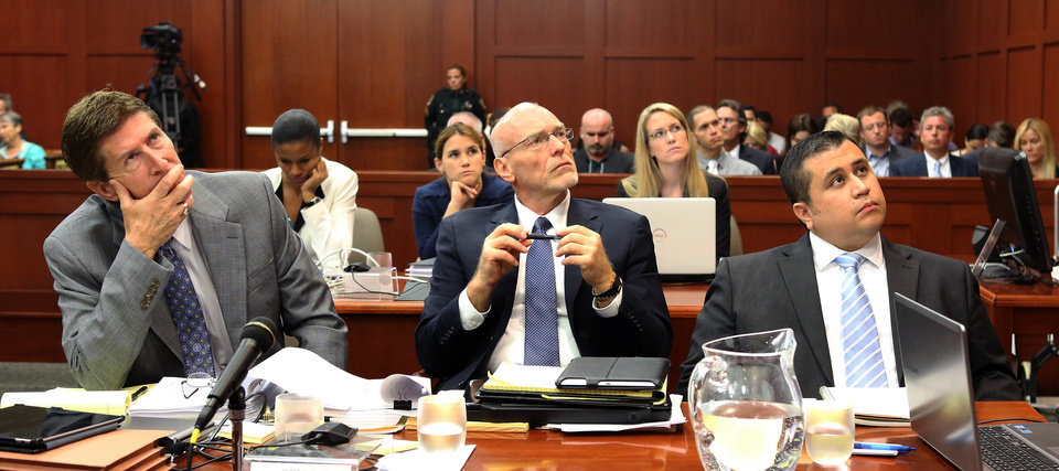 George Zimmerman, right, with his attorneys, Mark O'Mara, left, and Don West, center, watch as an evidence video is projected on a screen during the 16th day of his trial in Seminole circuit court, in Sanford, Fla., Monday, July 1, 2013. Zimmerman has been charged with second-degree murder for the 2012 shooting death of Trayvon Martin.(AP Photo/Orlando Sentinel, Joe Burbank, Pool)