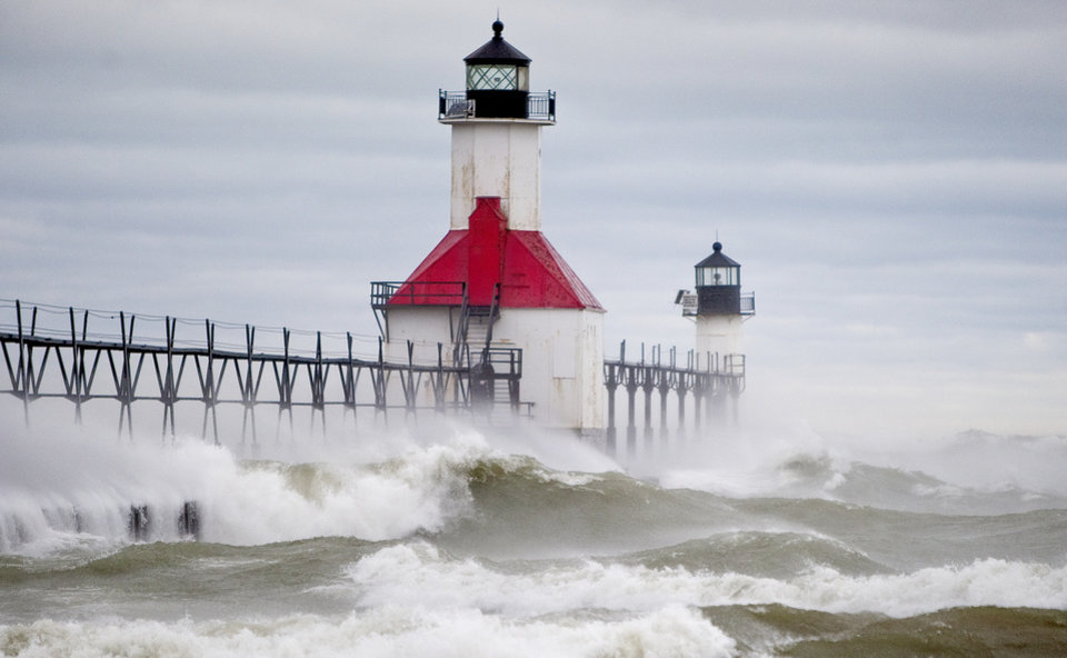 Winds from superstorm Sandy cause high waves to crash over the North Pier and into the St. Joseph Lighthouse in Saint Joseph, Mich., on Tuesday, Oct. 30, 2012. Much of the southern Lake Michigan lakeshore was pounded by the rough waters on Tuesday. (AP Photo/South Bend Tribune, Robert Franklin) MANDATORY CREDIT ORG XMIT: INSBE101
