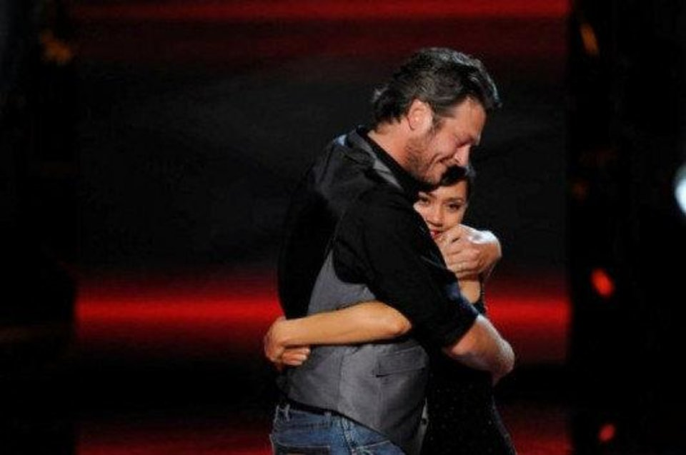 "Oklahoma country music star Blake Shelton embraces Dia Frampton, his teams' finalist on the hit reality TV show ""The Voice."" Frampton was the runner-up on the show's freshman season, narrowly losing to Javier Colon. NBC photo <strong></strong>"