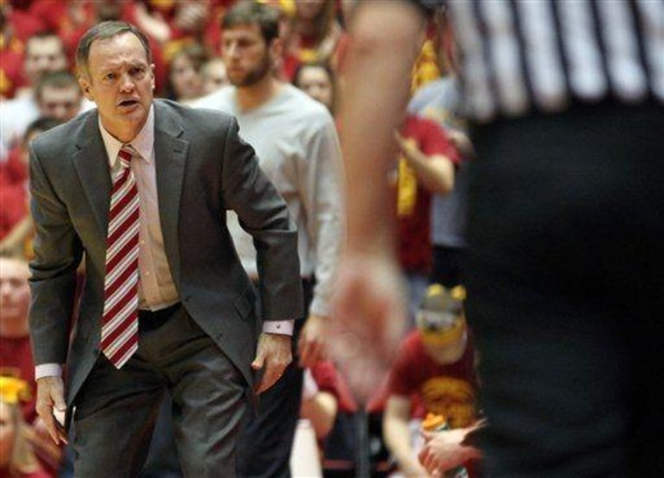 Oklahoma head coach Lon Kruger looks at an official after he thought a foul should have been called in the first half of their NCAA college basketball game against Iowa State Monday, Feb. 4, 2013, at Hilton Coliseum in Ames, Iowa. (AP Photo/Justin Hayworth)