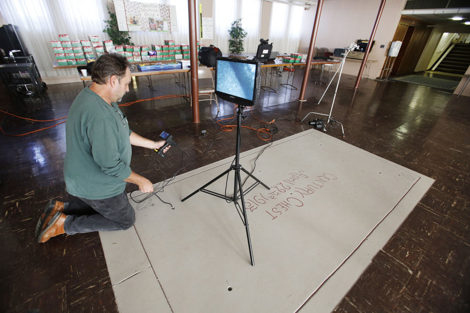 Photo - Videographer Andy Slaucitajs uses a borescope camera to look inside a structure containing the First Lutheran Church Century Chest at First Lutheran Church of Oklahoma City, 1300 N Robinson. Photo by Steve Gooch, The Oklahoman   Steve Gooch - The Oklahoman