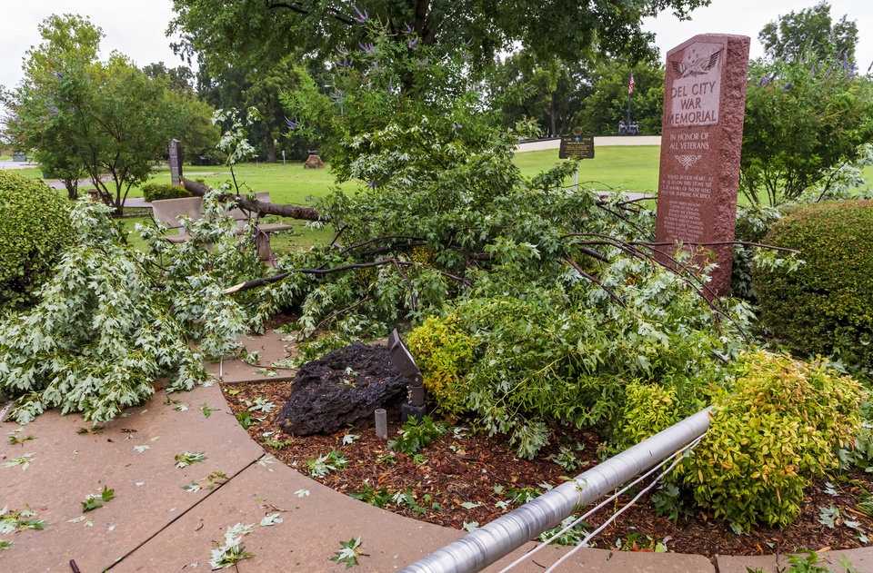 Photo - Tree limbs cover the Del City War Memorial after storms caused damage in Del City, Okla. on Tuesday, Aug. 27, 2019.   [Chris Landsberger/The Oklahoman]