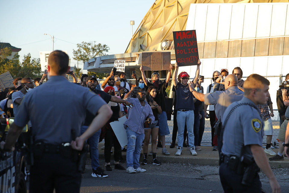 Photo - Protesters shout at members of the Oklahoma City police during a protest near the intersection of 23rd and Classen in Oklahoma City, Saturday, May 30, 2020. The protest was in response to the death of George Floyd. [Bryan Terry/The Oklahoman]