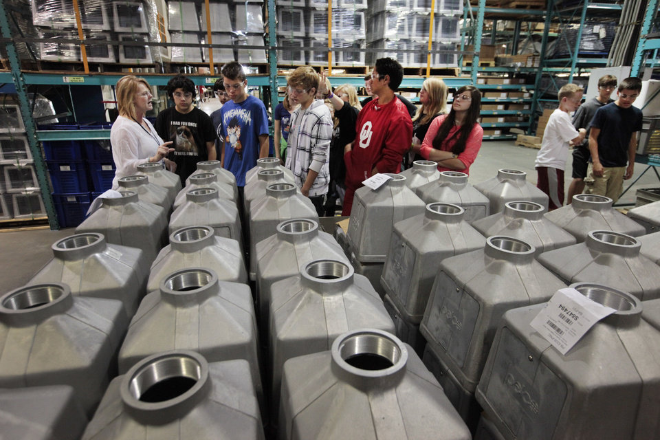 Eighth-grade students from Cimarron Middle School tour Pelco Products Inc. in Edmond as part of National Manufacturing Day Friday. <strong>David McDaniel - The Oklahoman</strong>