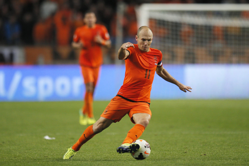 Photo - FILE - In this Oct. 11, 2013, file photo, In this Netherlands' Arjen Robben plays the ball during the Group D World Cup qualifying soccer match between Netherlands and Hungary, in Amsterdam, Netherlands. Robin van Persie and Arjen Robben continue to spark the Oranje, but Van Persie must seize the opportunity after the Manchester United striker has scored only once at the last two major tournaments, the 2010 World Cup and Euro 2012. (AP Photo/Peter Dejong, File)
