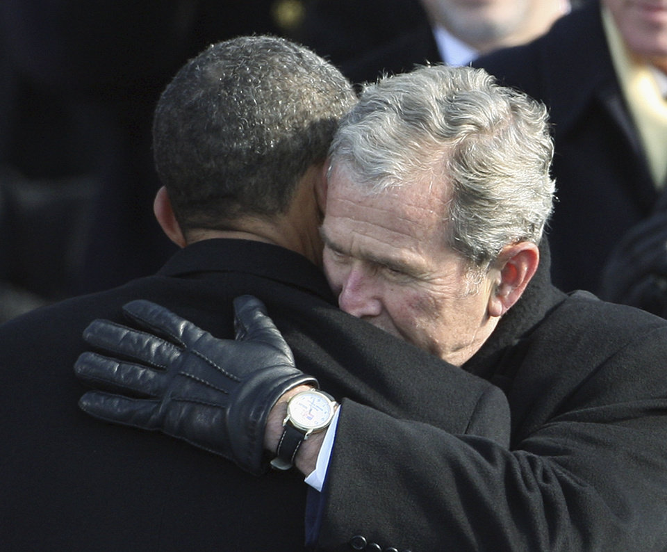 Photo - INAUGURATION / SWEARING IN / OATH OF OFFICE / HUG: Former President George W. Bush, right, hugs President Barack Obama after Obama was sworn in at the U.S. Capitol in Washington, Tuesday, Jan. 20, 2009.  (AP Photo/Ron Edmonds) ORG XMIT: CAPG153