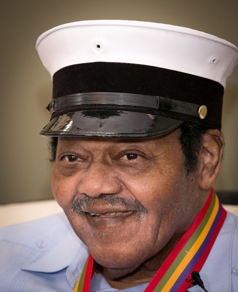"Legendary musician Fats Domino is named  ""Honorary Grand Marshall"" of the Krewe of Orpheus, the star-studded Carnival club that traditionally parades the night before Mardi Gras, Friday, Dec. 20, 2013 in New Orleans. (AP Photo/Doug Parker)."