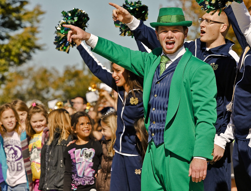 "The Notre Dame mascot leads the chant as the ""Band of The Fighting Irish,"" along with the spirit squads and mascot put on a special performance for the patients and employees of The Children's Center on Friday, Oct. 26, 2012, in Bethany, Okla. Photo by Chris Landsberger, The Oklahoman"