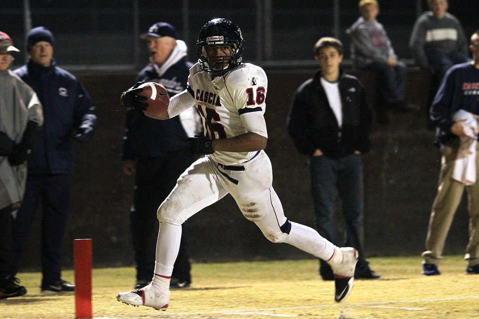 Photo - Cascia Hall's Abram McQuarters scores the Commandos' second touchdown during the Class 3A quarterfinals between Bethany and Cascia Hall in Bethany, Friday, November 25, 2011. PHOTO BY HUGH SCOTT, FOR THE OKLAHOMAN