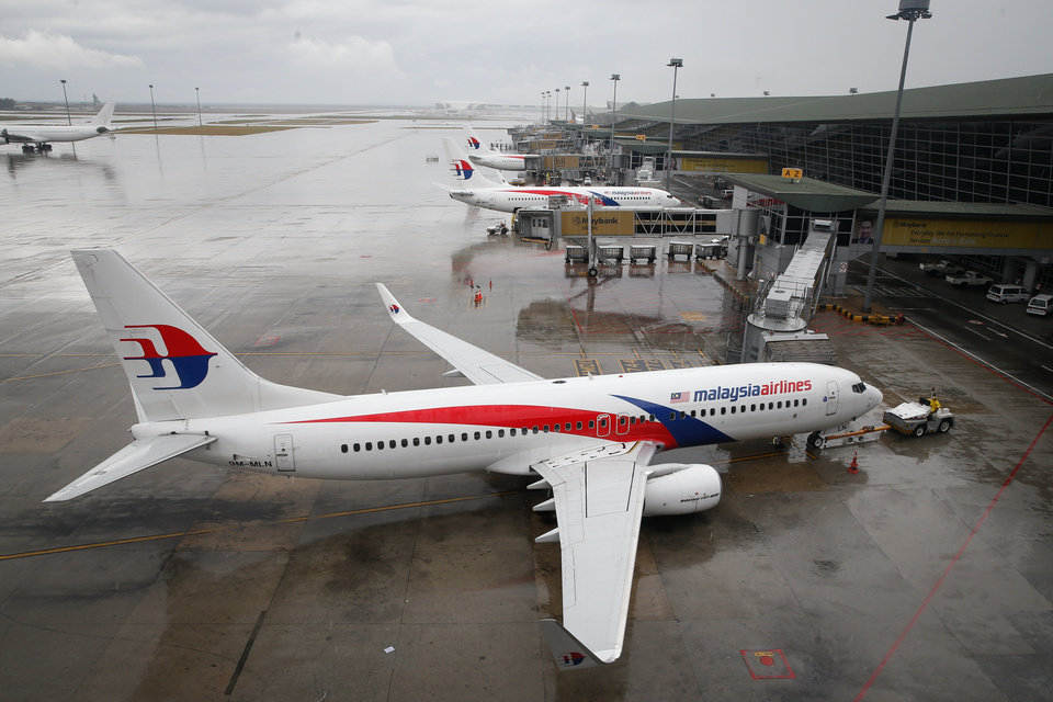 Photo -  A Malaysia Airlines Boeing 737-800 plane sits on the tarmac at Kuala Lumpur International Airport in Sepang, Malaysia, on Friday. AP Photo   Vincent Thian -
