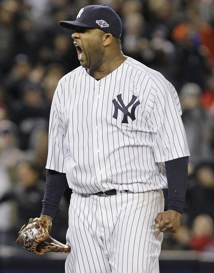 Photo -   New York Yankees starting pitcher CC Sabathia reacts after Baltimore Orioles' J.J. Hardy grounded out with the bases loaded to end the eighth inning of Game 5 of the American League division baseball series Friday, Oct. 12, 2012, in New York. (AP Photo/Kathy Willens)