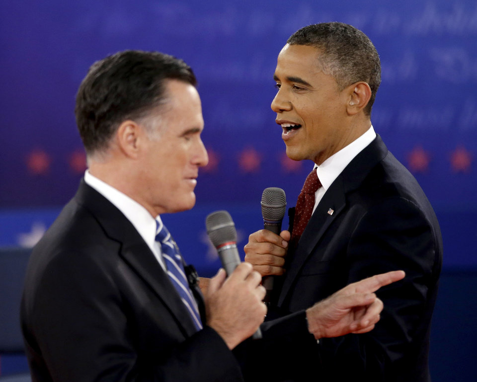 Photo - FILE - In this Oct. 16, 2012 file photo, President Barack Obama, right, and Republican presidential candidate, former Massachusetts Gov. Mitt Romney exchange views during the second presidential debate at Hofstra University in Hempstead, N.Y. Obama and Romney, bitter campaign foes just weeks ago, are to share a lunch on Thursday, Nov. 29, 2012, at the White House with an eye on overlapping interests rather than the sharp differences that defined their presidential contest. (AP Photo/David Goldman, File)