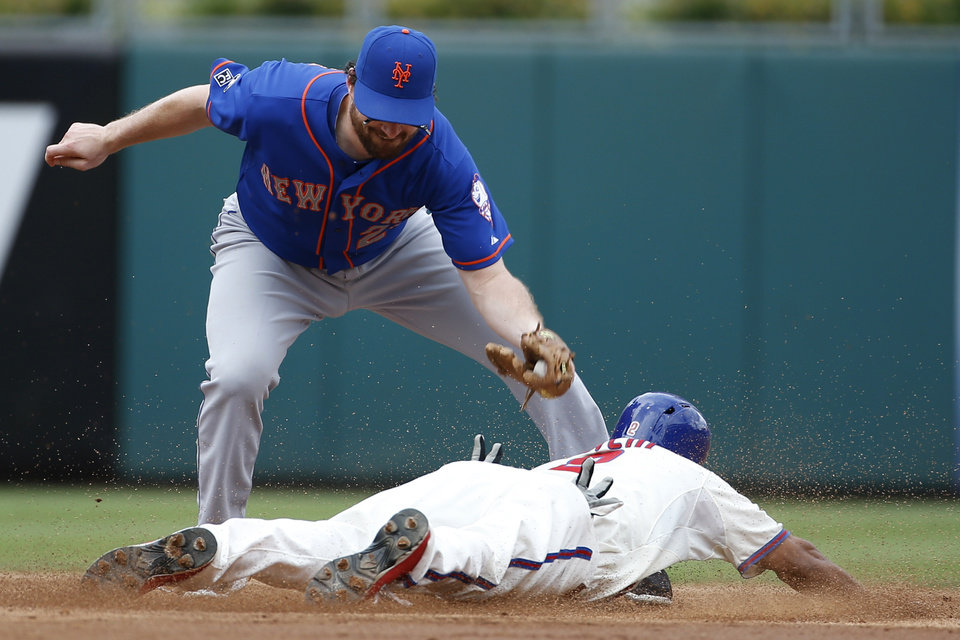 Photo - Philadelphia Phillies' Ben Revere, right, steals second under the tag from New York Mets second baseman Daniel Murphy during the third inning of a baseball game, Monday, Aug. 11, 2014, in Philadelphia. (AP Photo/Matt Slocum)