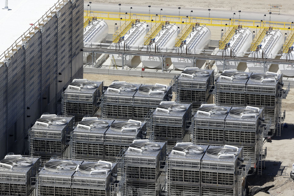 This June 6, 2013, photo, shows an aerial view of the cooling units at the NSA's Utah Data Center in Bluffdale, Utah. The nation's new billion-dollar epicenter for fighting global cyberthreats sits just south of Salt Lake City, tucked away on a National Guard base at the foot of snow-capped mountains. The long, squat buildings span 1.5 million square feet, and are filled with super-powered computers designed to store massive amounts of information gathered secretly from phone calls and emails. (AP Photo/Rick Bowmer)