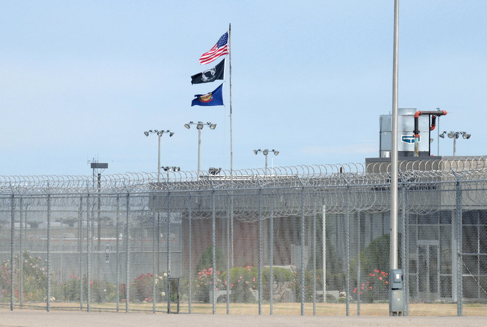 Photo - Flags fly outside the Idaho Maximum Security Institution following the execution of Richard Leavitt on Tuesday, June 12, 2012 in Kuna, Idaho. Prison officials declared Leavitt, 53, dead at 10:25 a.m. Tuesday by lethal injection at the Idaho Maximum Security Institution. It was only Idaho's second execution in 17 years.  Leavitt was convicted of stabbing 31-year-old Danette Elg, of Blackfoot, in 1984. An Associated Press investigation showed that the state's contract with private prison giant Corrections Corporation of America didn't save taxpayers any money at all despite a decade of state leaders promising otherwise. (AP Photo/Idaho Press-Tribune, Greg Kreller) MANDATORY CREDIT