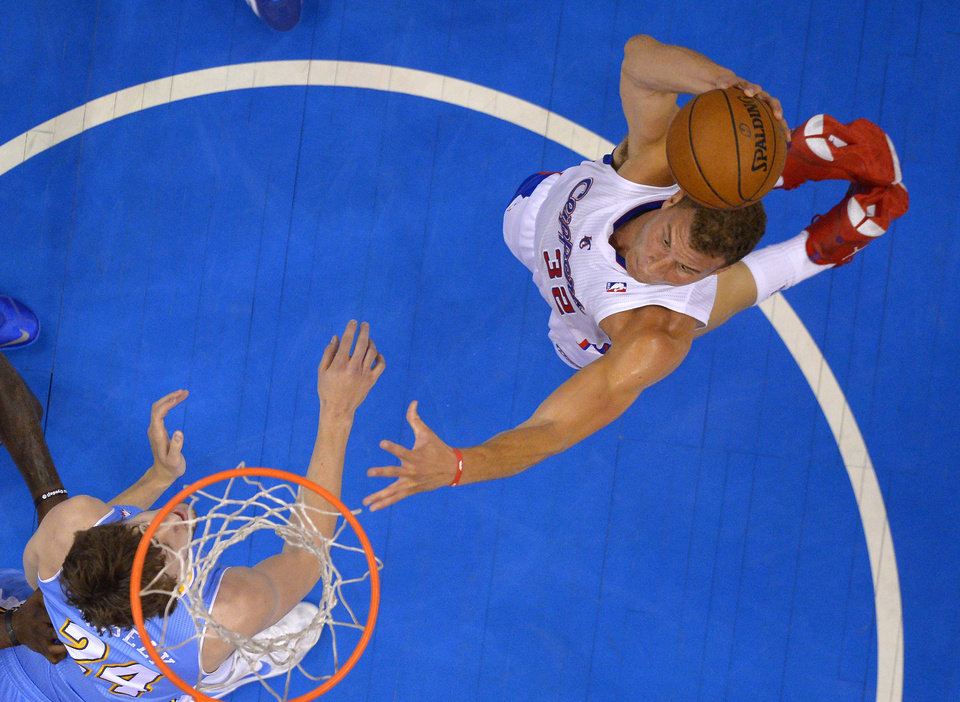 Photo - Los Angeles Clippers forward Blake Griffin, right, goes up for a dunk as Denver Nuggets forward Jan Vesely, of the Czech Republic, defends during the first half of an NBA basketball game, Tuesday, April 15, 2014, in Los Angeles.  (AP Photo/Mark J. Terrill)