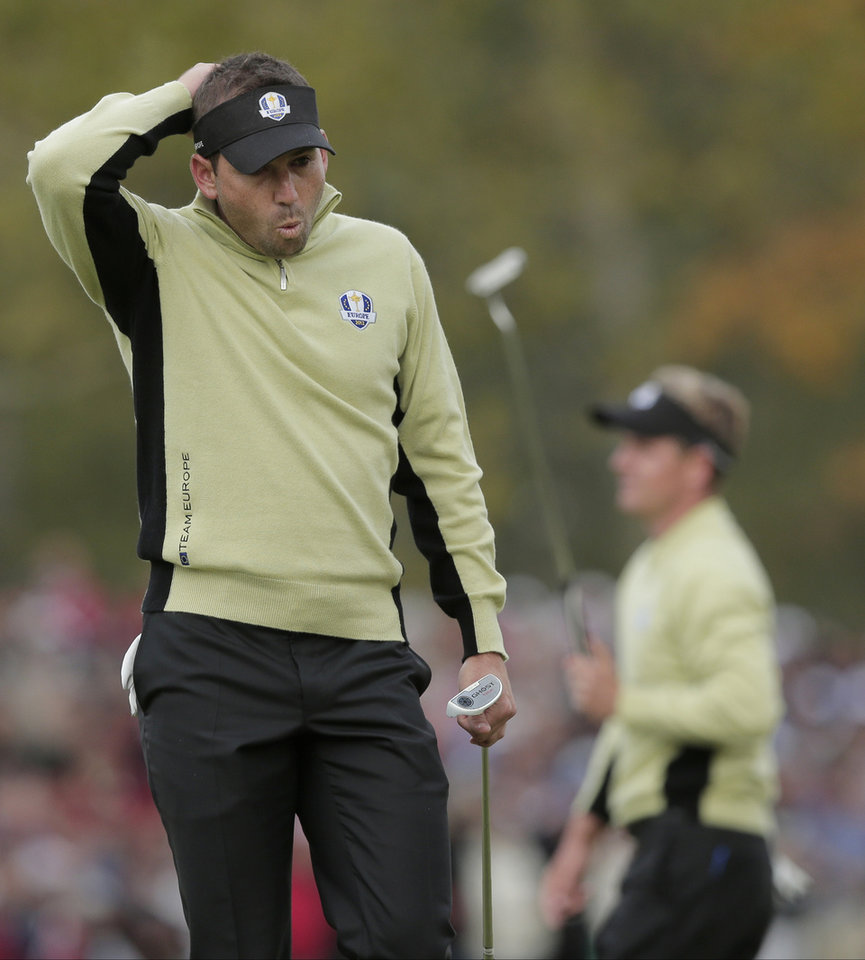 Photo -   Europe's Sergio Garcia, left, reacts after teammate Luke Donald misses a putt on the fifth hole during a foresomes match at the Ryder Cup PGA golf tournament Friday, Sept. 28, 2012, at the Medinah Country Club in Medinah, Ill. (AP Photo/Charlie Riedel)