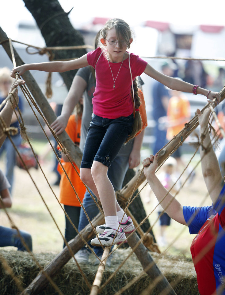 Photo - Caiton Beesley, from Pretty Water School, crosses a rope bridge during school day of the Oklahoma Wildlife Expo at the Lazy E Arena and Ranch in Guthrie, OK, Friday, September 28, 2012,  By Paul Hellstern, The Oklahoman