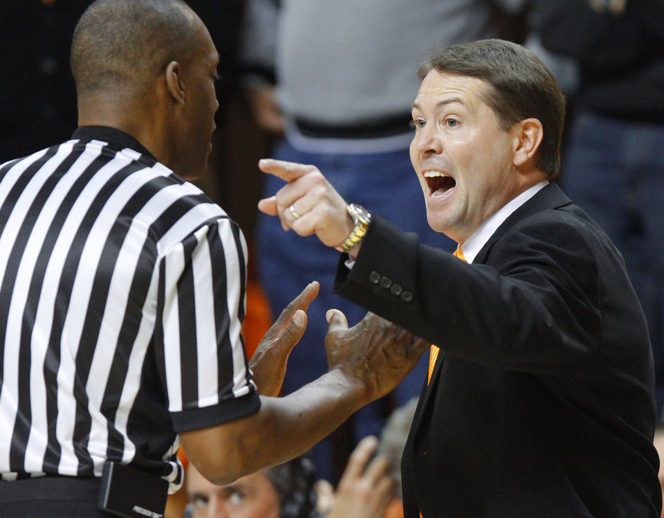 Photo - Oklahoma State coach Travis Ford shouts towards official Terry Moore during an NCAA college basketball game between the Oklahoma State University Cowboys (OSU) and the Kansas State University Wildcats (KSU) at Gallagher-Iba Arena in Stillwater, Okla., Saturday, Jan. 21, 2012. Photo by Bryan Terry, The Oklahoman