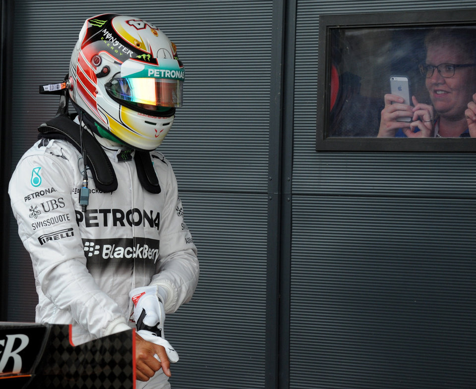 Photo - Britain's Lewis Hamilton of Mercedes leaves the pits after qualifying in sixth place forSunday's British Formula One Grand Prix at Silverstone circuit, Silverstone, England, Saturday, July 5, 2014. The British Formula One Grand Prix will be held on Sunday, July 6, 2014. (AP Photo/Rui Vieira)