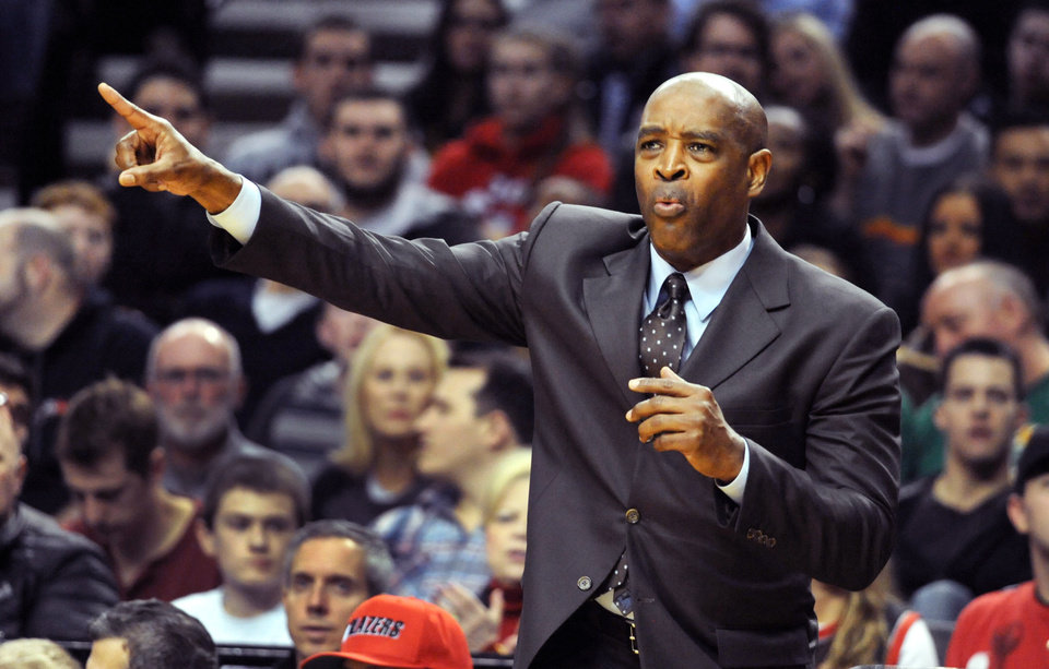 Photo - Milwaukee Bucks head coach Larry Drew directs his team during the first half of an NBA basketball game against the Portland Trail Blazers in Portland, Ore., Tuesday, March 18, 2014. (AP Photo/Steve Dykes)