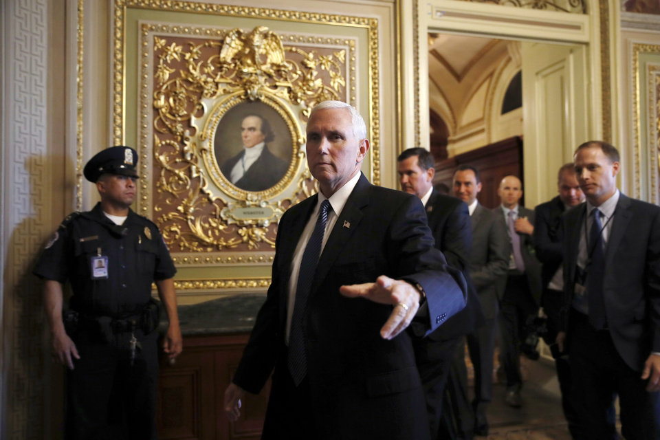 "Photo - Vice President Mike Pence walks in the Capitol on Capitol Hill in Washington, Wednesday, May 10, 2017.    Pence defended the firing of FBI Director Comey, saying the ""president made the right decision at the right time."" He said Comey's firing was not related to the investigation into possible contacts between the Trump presidential campaign and Russia. (AP Photo/Jacquelyn Martin)"