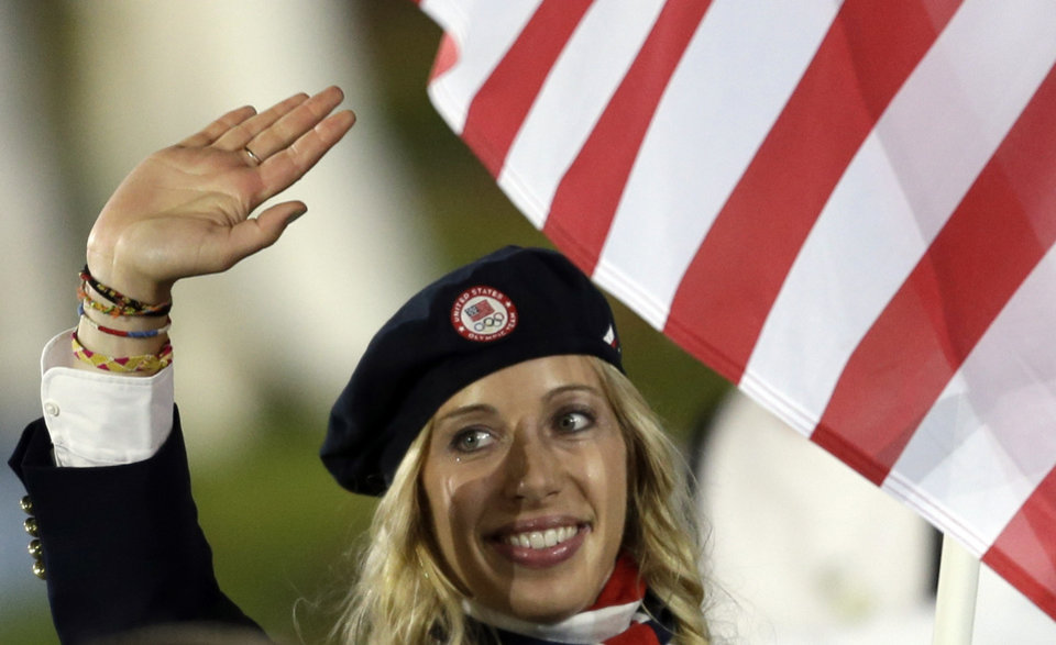 United States's Mariel Zagunis carries the flag during the Opening Ceremony at the 2012 Summer Olympics, Friday, July 27, 2012, in London. (AP Photo/David Goldman) ORG XMIT: OLYOC634