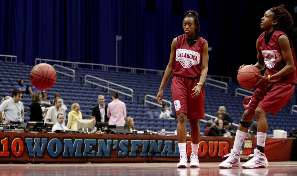 OU's Nyeshia Stevenson, left, and Danielle Robinson shoot the ball during practice for the Final Four of the NCAA women's  basketball tournament at the Alamodome in San Antonio, Texas., on Saturday, April 3, 2010.  The University of Oklahoma will play Stanford on Sunday, April 4, 2010.