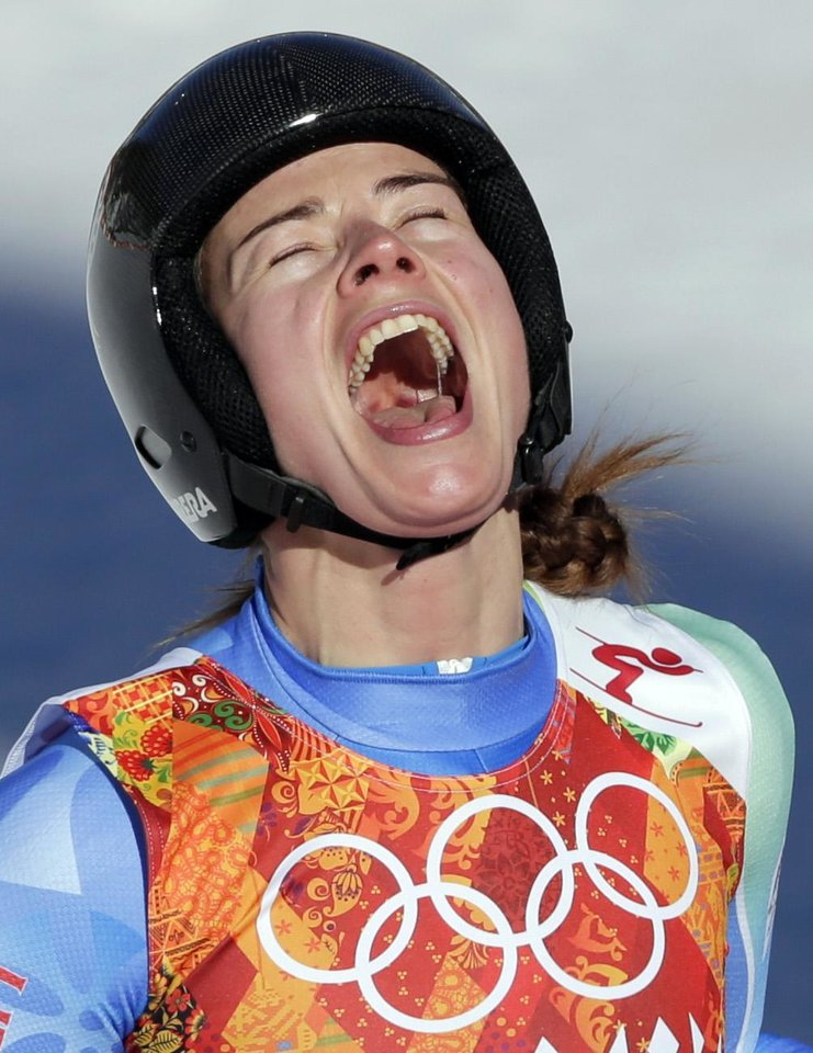 Photo - Slovenia's Tina Maze celebrates after finishing in the women's downhill at the Sochi 2014 Winter Olympics, Wednesday, Feb. 12, 2014, in Krasnaya Polyana, Russia. (AP Photo/Gero Breloer, File)