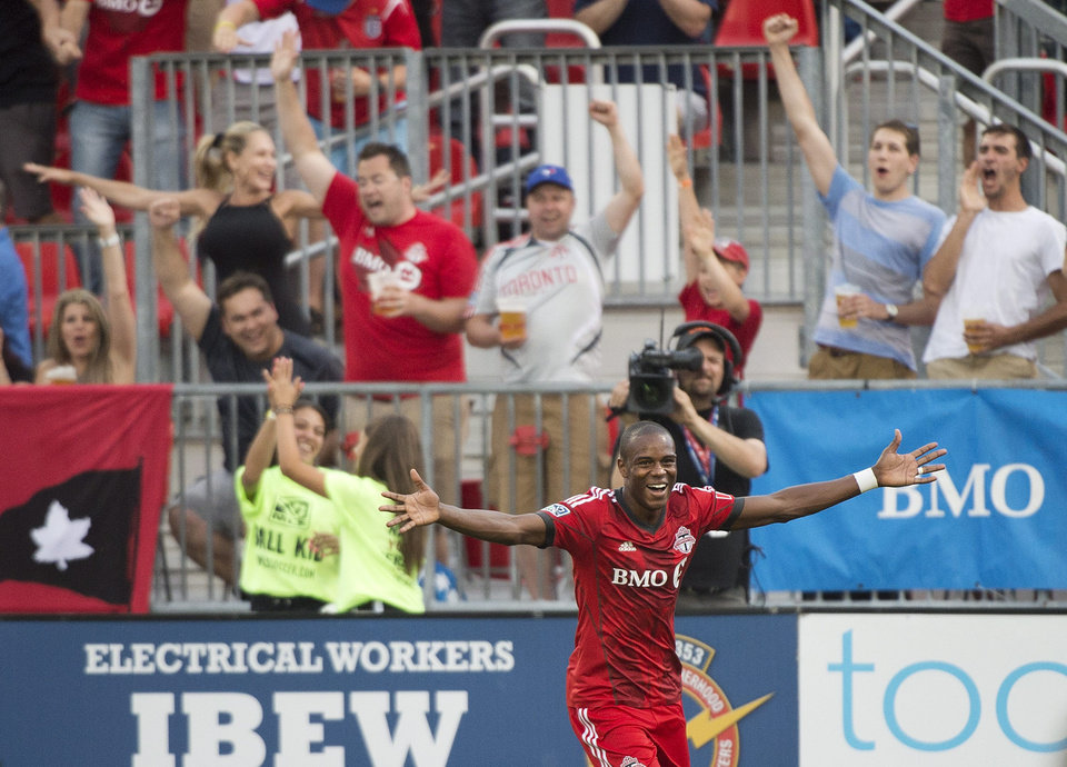 Photo - Toronto FC midfielder Jackson celebrates after scoring against Sporting Kansas City during the first half of an MLS soccer game Saturday, July 26, 2014, in Toronto. (AP Photo/The Canadian Press, Nathan Denette)