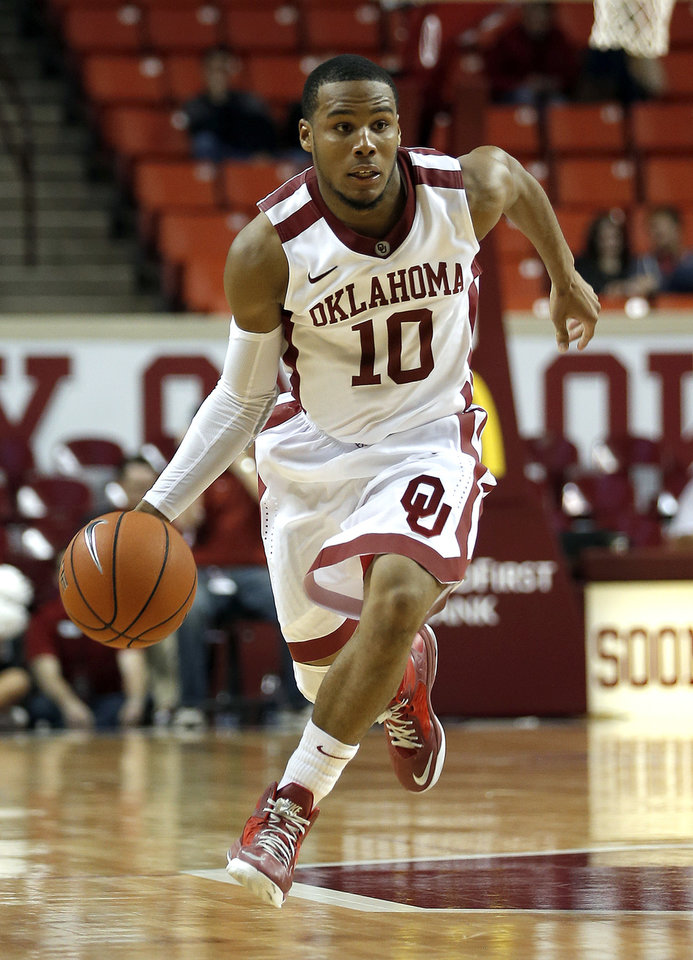 Oklahoma's Jordan Woodard (10) drives up court during the men's college basketball game between the University of Oklahoma and UT-Arlington, at the LLoyd Noble Center in Norman, Okla. Tuesday, Dec. 17, 2013. Photo by Sarah Phipps, The Oklahoman
