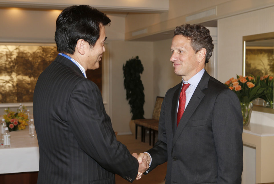 U.S. Treasury Secretary Timothy Geithner, right, is welcomed by Japanese Finance Minister Koriki Jojima prior to their talks held on the sideline of the annual IMF/World Bank meetings in Tokyo Thursday, Oct. 11, 2012. Speaking at a financial conference Geithner said that financial reforms and other actions in response to the global crisis are yielding results, helping the U.S. economy to grow at a pace better than there was reason to expect. (AP Photo/Shizuo Kambayashi, Pool)