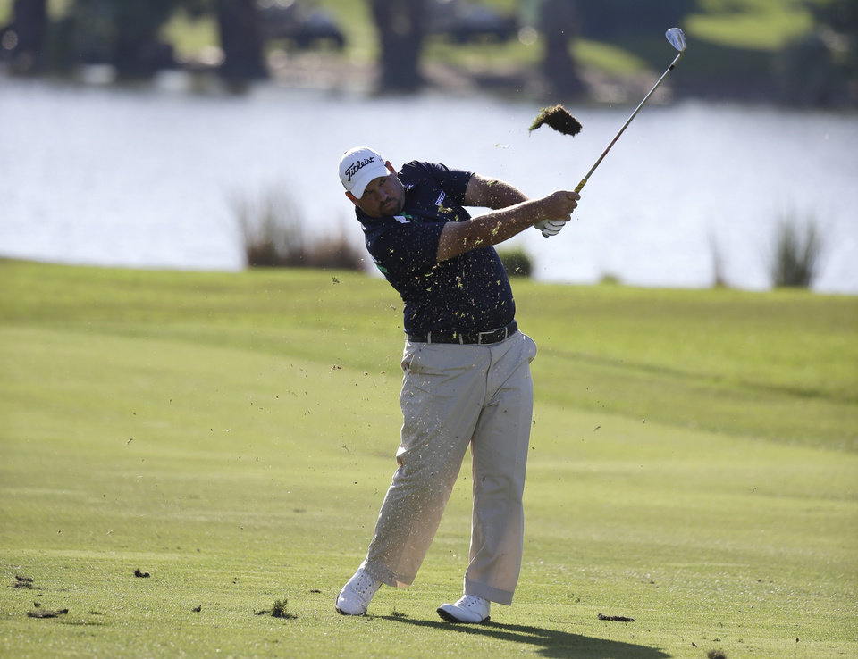 Photo - Brendon de Jonge, of Zimbabwe, hits on the ninth fairway during the second round of the Honda Classic golf tournament on Friday, Feb. 28, 2014, in Palm Beach Gardens, Fla. (AP Photo/Lynne Sladky)