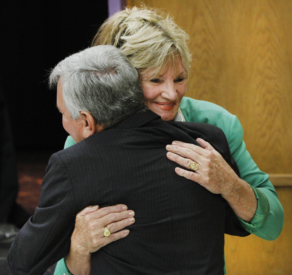 Photo - Oklahoma City Public Schools board Chairwoman Lynne Hardin embraces Dave Lopez after the board votes unanimously to appoint him as interim superintendent of the school district on Monday   - Photo by Steve Gooch, The Oklaho