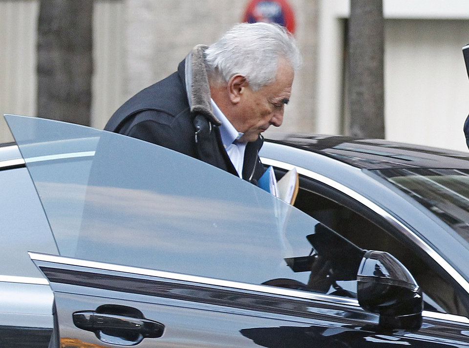 Former International Monetary Fund leader Dominique Strauss-Kahn enters his car after leaving his apartment building in Paris, Monday Dec. 10, 2012. The outcome of a New York City hotel housekeeper\'s sexual assault lawsuit against Dominique Strauss-Kahn will be settled Monday in a New York court. (AP Photo/Remy de la Mauviniere)