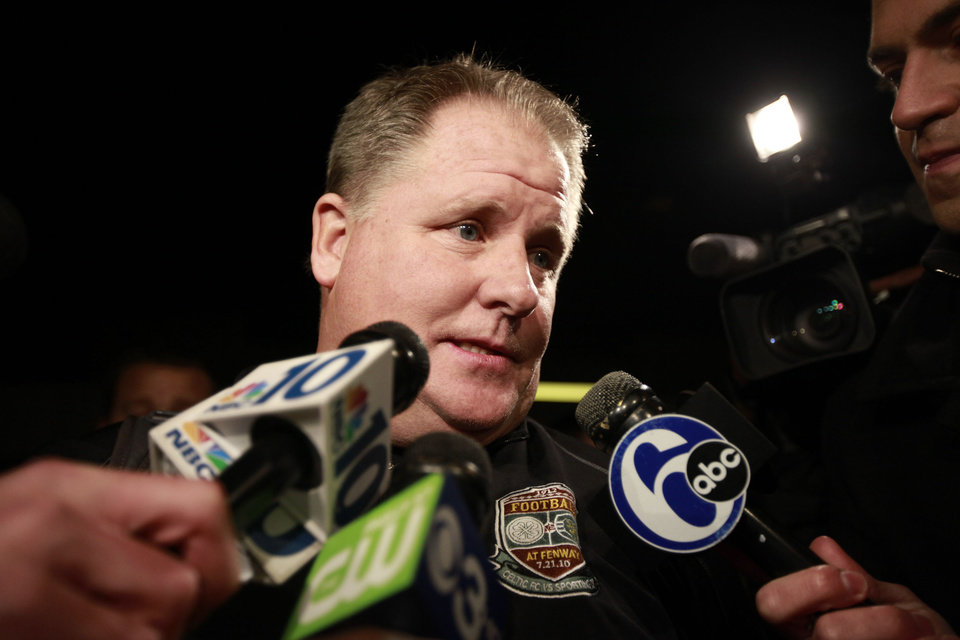 Chip Kelly speaks to members of the media as he arrives at Northeast Philadelphia Airport, Wednesday, Jan. 16, 2013, in Philadelphia. Oregon's enigmatic NCAA college football head coach of four years surprised the school with an early morning phone call Wednesday to say he was leaving to become head coach of the Philadelphia Eagles NFL football team, just a little more than a week after he told Oregon he was staying. (AP Photo/The Philadelphia Inquirer, David Swanson)  PHIX OUT; TV OUT; MAGS OUT; NEWARK OUT