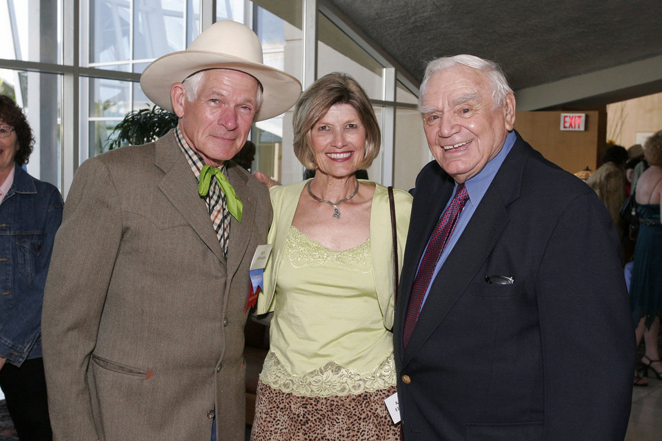 Photo - Honoree Don Edwards and Kathy Edwards visit with actor Ernest Borgnine, a presenter at the Western Heritage Awards Jingle-Jangle Mingle reception for honorees and patrons, at the museum the evening before the awards ceremony. BY DAVID FAYTINGER, FOR THE OKLAHOMAN