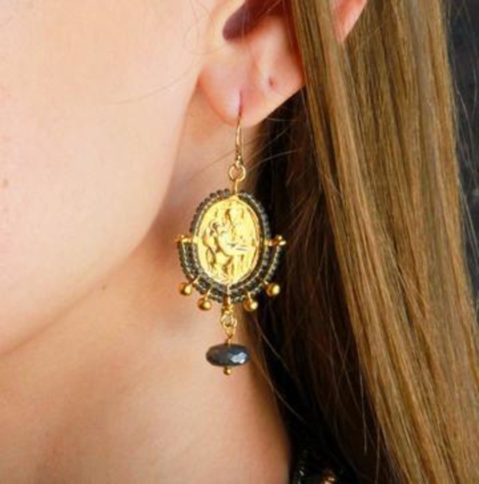 Photo - Catherine Page earrings feature tiny reproductions of Michelangelo's Pieta sculpture in Florence surrounded with seed pearls and finished with gold dangles.