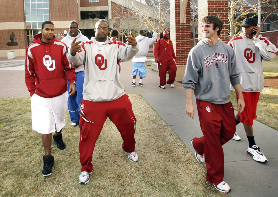 Photo - OU / BCS RANKINGS: University of Oklahoma college football players including Gerald McCoy (gesturing) and Joey Halzle (second from right) leave the Switzer Center after watching results of the Bowl Championship Series ranking in Norman, Oklahoma on Sunday, November 30, 2008.     By Steve Sisney, The Oklahoman   ORG XMIT: KOD