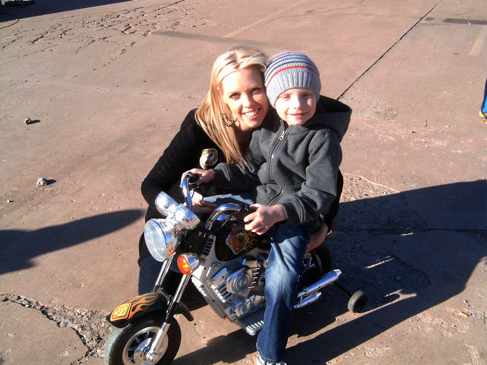 Nathan Butler, with his mother, Stephanie Butler, is shown on a bike at a weekend benefit that will help defray Nathan�s medical expenses for cancer treatment. Photo by Steve Gust, for The Oklahoman