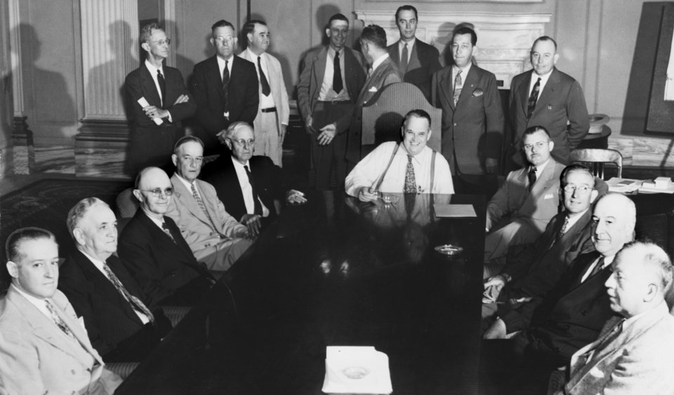 ROBERT S. KERR / OKLAHOMA CITY, OKLAHOMA / GOVERNOR:  Fate of the State Is Pondered by New Planning Board - With Governor Kerr seated at the end of the table, the new state planning and resources board took office Wednesday.  Seated from left to right around the table, K.S. Adams, Bartlesville;  Lloyd Judd, Oklahoma City (member post-war commission); J.G. Puterbaugh, McAlester;  Victor Barnett, Tulsa;  C.C. Pearson, Oklahoma City; Early C. Love, Chandler; Homer Johnson, Boise City;  John Craig, Idabel; W.C. Austin, Altus.  Standing behind the governor are Dan Mock, Cherokee; B.D. Eddy, Oklahoma City; Dr. Henry G. Bennett, E.W. Smart, chairman and Al Cook, Oklahoma City.  Newt Graham of Tulsa was not present.  Staff photo by C.J. Kaho.  Photo dated 07/07/1943.  Published on 07/07/1943 in The Oklahoma City Times