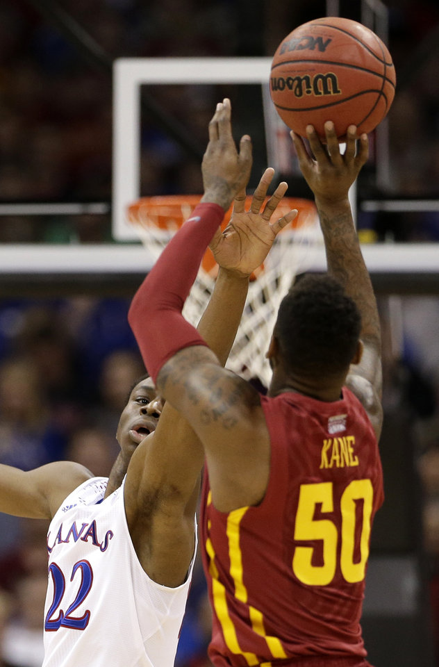 Photo - Kansas' Andrew Wiggins (22) tries to block a shot by Iowa State's DeAndre Kane (50) during the first half of an NCAA college basketball game in the Big 12 men's tournament on Friday, March 14, 2014, in Kansas City, Mo. (AP Photo/Charlie Riedel)