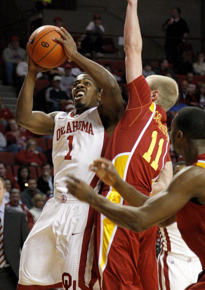 Oklahoma's Sam Grooms (1) goes past Iowa State's Scott Christopherson (11) during an NCAA basketball game between the University of Oklahoma Sooners (OU) and the Iowa State Cyclones (ISU) at the Lloyd Noble Center in Norman, Saturday, Feb. 4, 2012. Photo by Bryan Terry, The Oklahoman