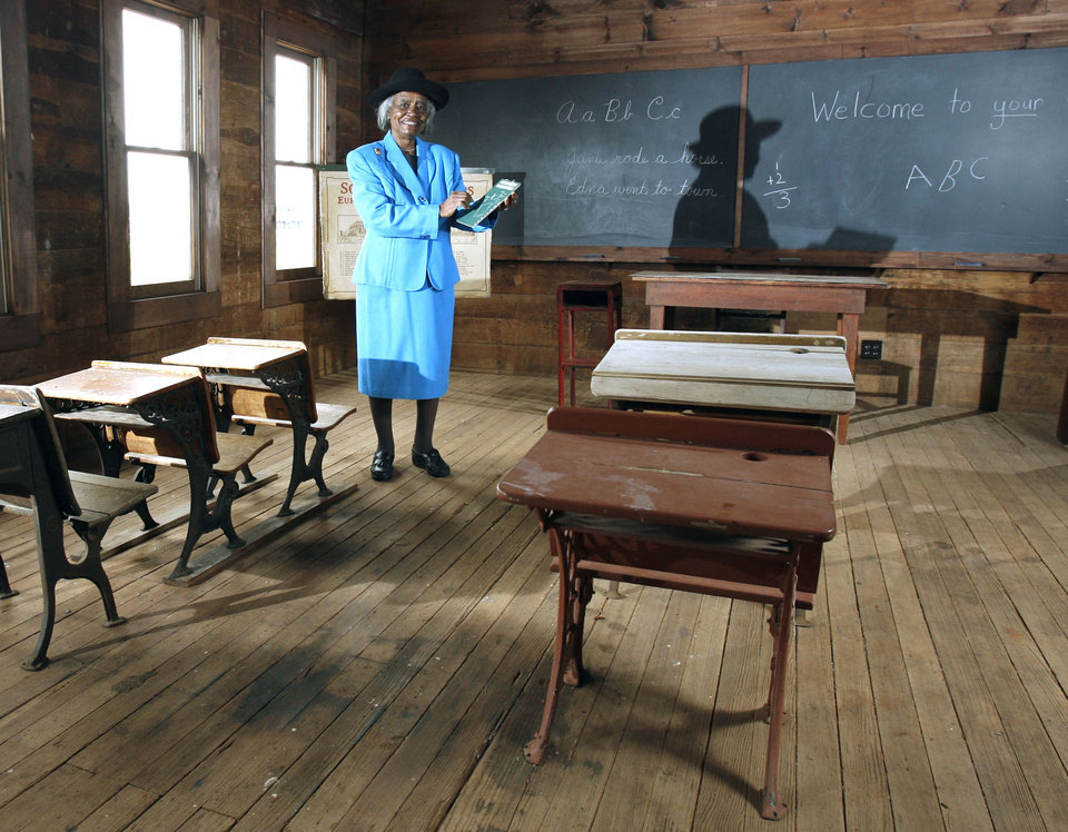 Photo - VERDEN SEPARATE ONE-ROOM SCHOOL / SCHOOLHOUSE / RENOVATE / RENOVATED / RENOVATION / DEDICATE / DEDICATION / BLACK STUDENTS / VERDEN SEPARATE SCHOOL: Loretta Jackson stands inside a