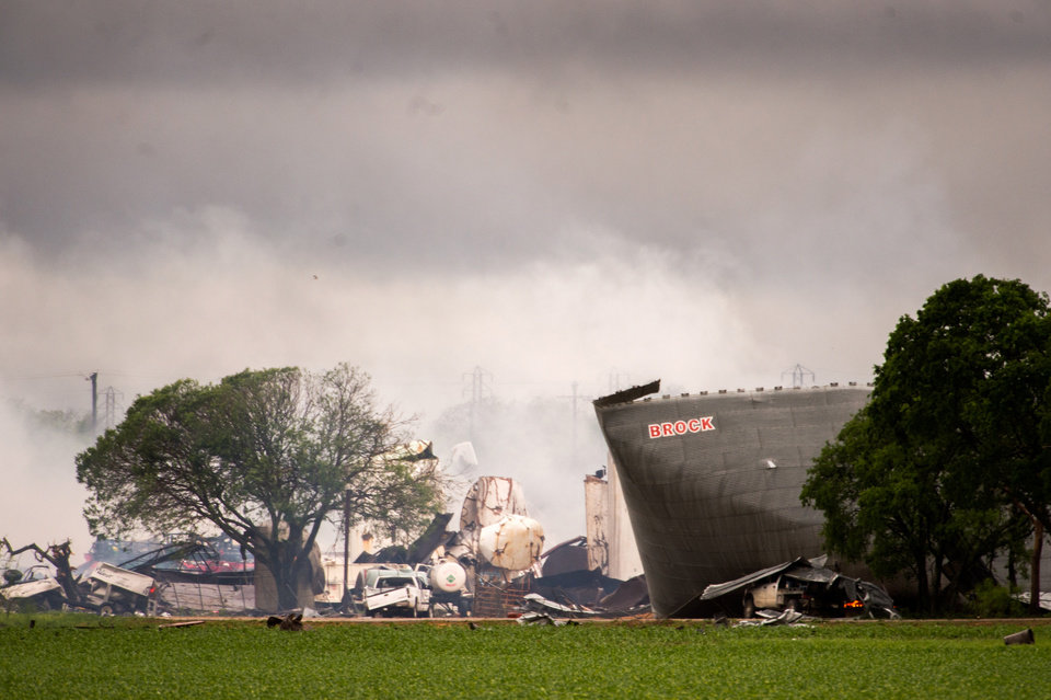 Photo - The remains of the the West Fertilizer Co. plant smolder in the rain on Thursday, April 18, 2013, in West, Texas.  A massive explosion at the plant killed as many as 15 people and injured more than 160, officials said overnight.   (AP Photo/Houston Chronicle,  Smiley N. Pool) MANDATORY CREDIT
